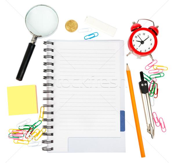 Abrir caderno artigos de papelaria despertador isolado branco Foto stock © cherezoff
