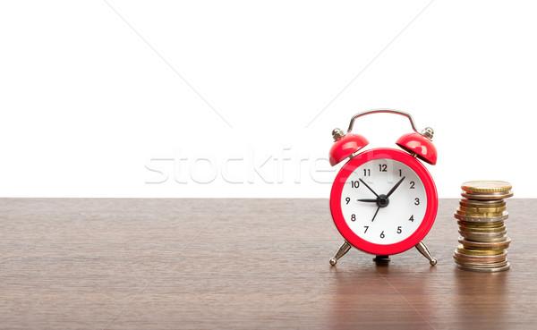 Despertador moedas isolado branco ouro Foto stock © cherezoff