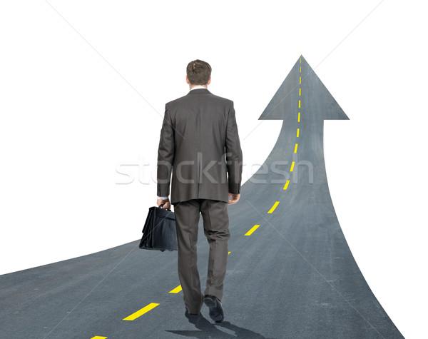 бизнесмен ходьбе дороги вверх стрелка изолированный Сток-фото © cherezoff