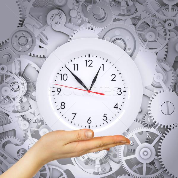 Hand hold clock with gears Stock photo © cherezoff
