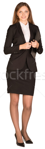 Business woman holding a paper holder and pen Stock photo © cherezoff