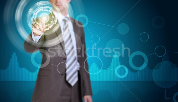 бизнесмен костюм пальца виртуальный кнопки свечение Сток-фото © cherezoff