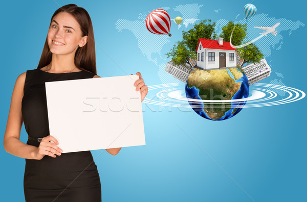 Beautiful businesswoman holding paper holder. Earth with buildings and trees Stock photo © cherezoff
