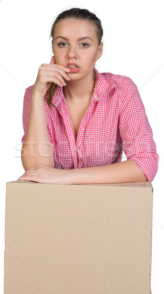 Woman leaning on cardboard box Stock photo © cherezoff