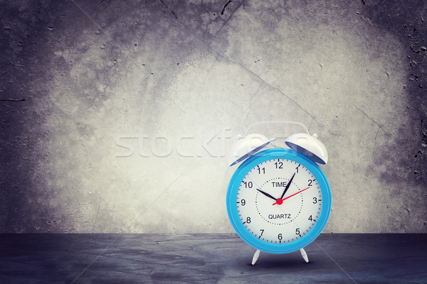 Concrete wall with fissure. Alarm clock in front at camera Stock photo © cherezoff