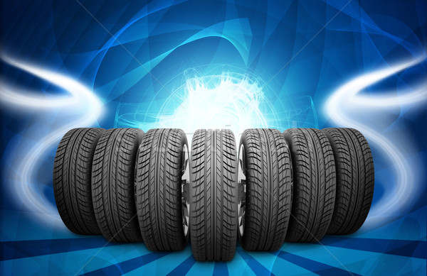 Wedge of new car wheels. Abstract background is lines and stripes at bottom Stock photo © cherezoff