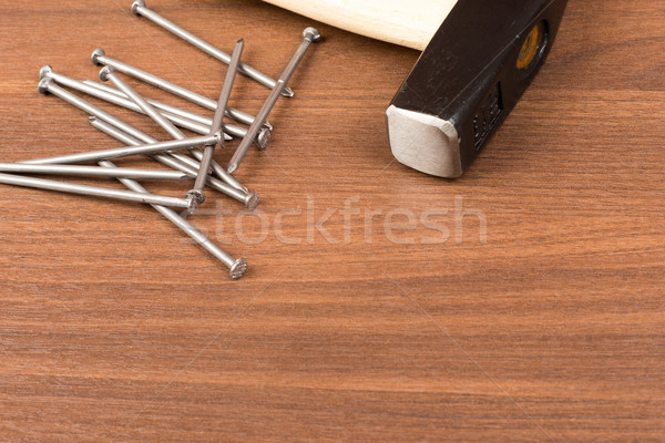 Hammer and nails on table Stock photo © cherezoff