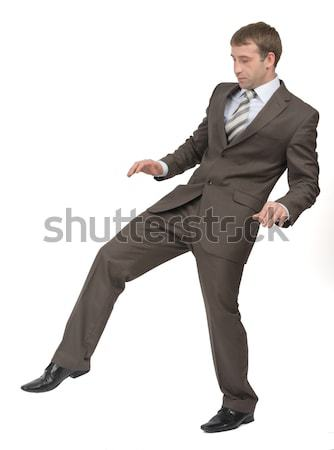 Businessman walking gingerly Stock photo © cherezoff