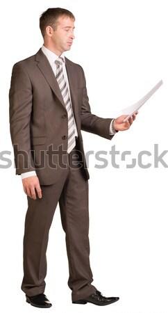 üzletember tart nehéz üres hely izolált fehér Stock fotó © cherezoff