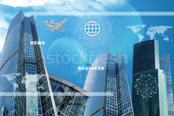 Skyscrapers with world map Stock photo © cherezoff