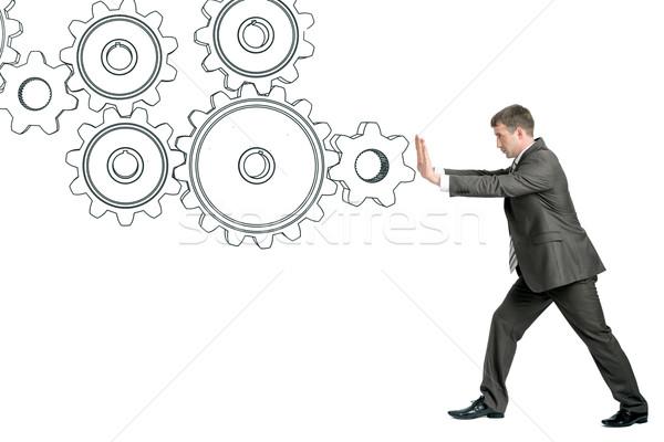 Geschäftsmann schieben cog Räder isoliert weiß Stock foto © cherezoff