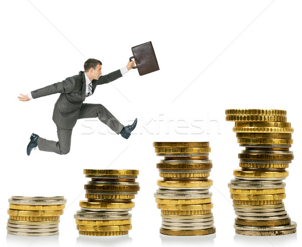 бизнесмен работает Золотые монеты изолированный белый костюм Сток-фото © cherezoff