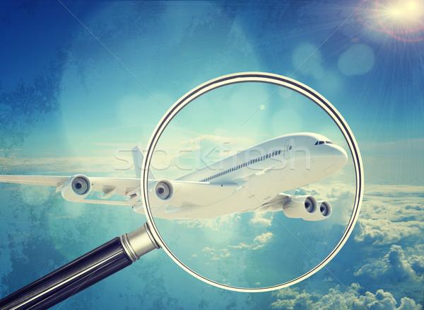 Jet under magnifier, close-up view Stock photo © cherezoff