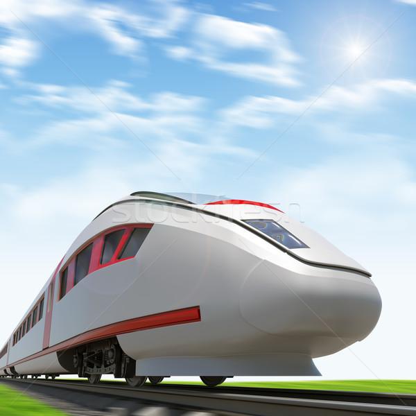 Train moving forward on rail-tracks with sun Stock photo © cherezoff