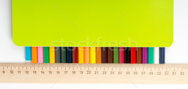 Set of crayons with ruler and copybook Stock photo © cherezoff