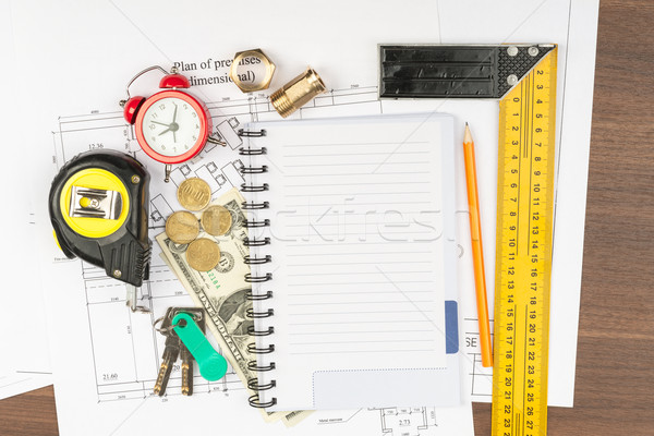 Copybook with drawings on table Stock photo © cherezoff