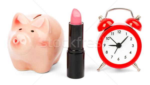 Lipstick with piggy bank on white Stock photo © cherezoff
