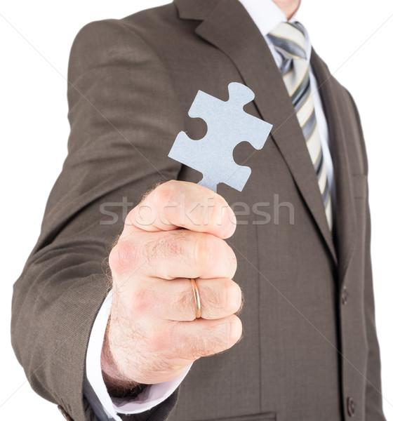 Businessman or innovator holding puzzle piece  Stock photo © cherezoff