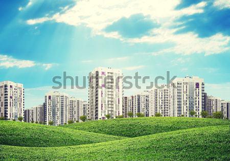 Bâtiments vert collines route ciel Photo stock © cherezoff
