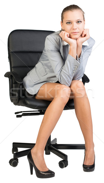 Businesswoman on office chair with head reclined upon her hands Stock photo © cherezoff