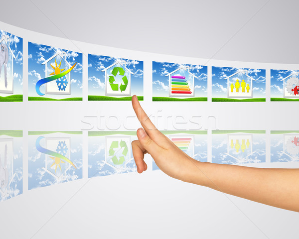 Icons smart buildings. Finger presses one of virtual screens Stock photo © cherezoff