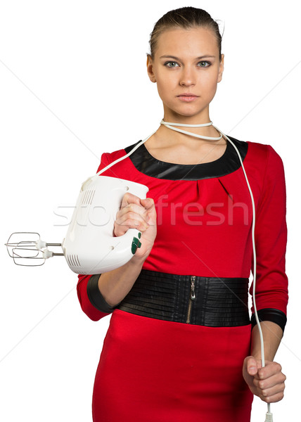 Jeune femme mixeur cordon regarder Photo stock © cherezoff