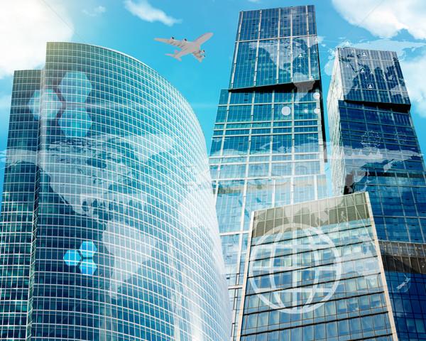 World map with molecule and skyscraper Stock photo © cherezoff