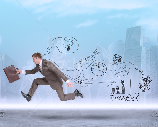 Businessman running fast with suitcase and symbols Stock photo © cherezoff