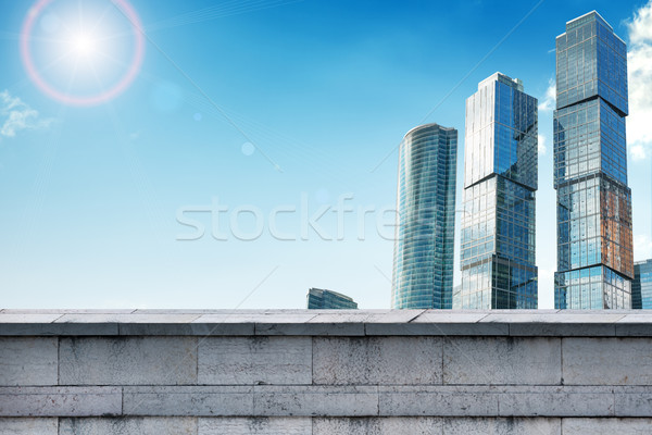 Skyscrapers with grey wall Stock photo © cherezoff