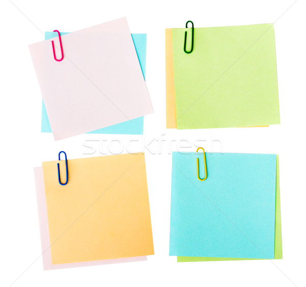 Colorful notes with clips on white Stock photo © cherezoff