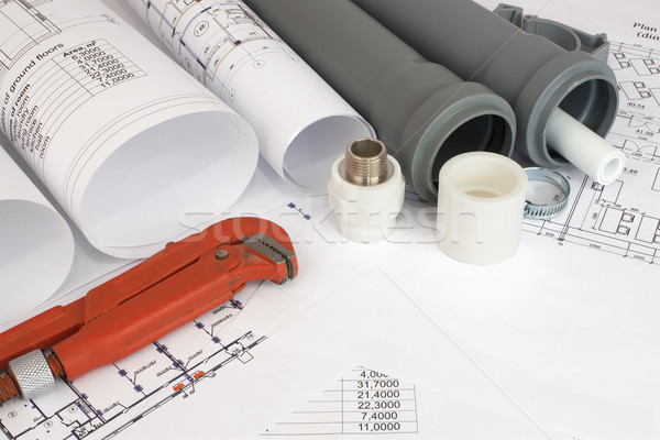 Plumbing tools on the construction drawings Stock photo © cherezoff