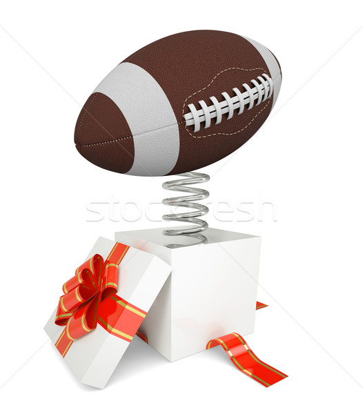 Gift box with red band and rugby ball on spring Stock photo © cherezoff