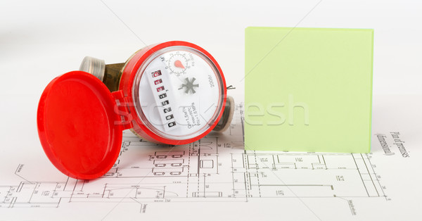 Water meter with green sticker on draft Stock photo © cherezoff