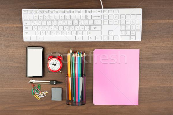 Okostelefon irodaszerek fa asztal fa billentyűzet elektronika Stock fotó © cherezoff