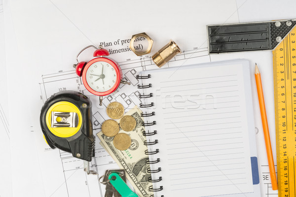 Copybook with drawings and tape measure Stock photo © cherezoff