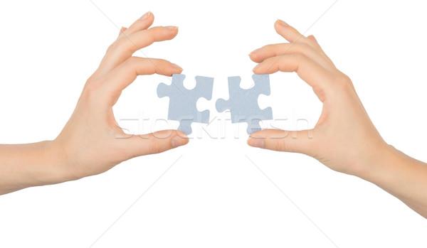 Mãos peças do puzzle isolado branco mão Foto stock © cherezoff