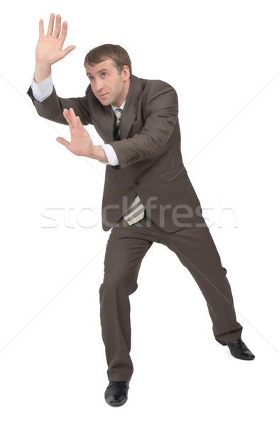 Businessman pushing empty space on white Stock photo © cherezoff