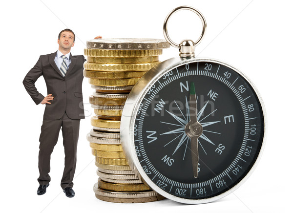 Businessman with big stack of coins Stock photo © cherezoff