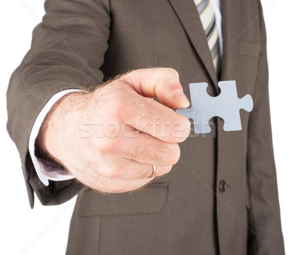Businessman holding puzzle piece Stock photo © cherezoff