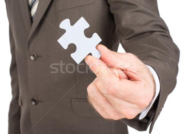 Business man showing jigsaw puzzle piece  Stock photo © cherezoff