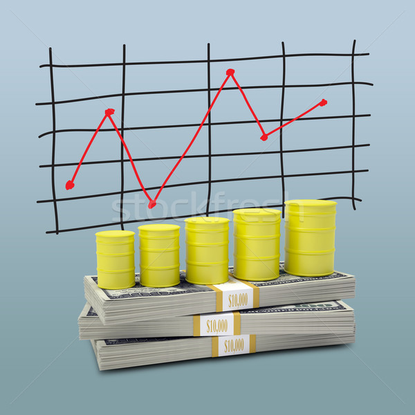 Barrels gas stand on pack of dollars Stock photo © cherezoff