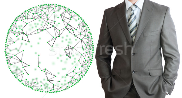Businessman in a suit with wire frame sphere Stock photo © cherezoff