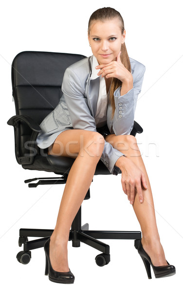 Businesswoman on office chair with head reclined upon her hand Stock photo © cherezoff