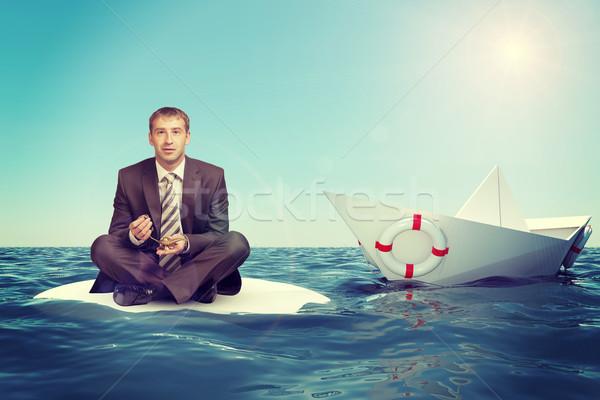 üzletember ül lótusz pozició papír csónak Stock fotó © cherezoff