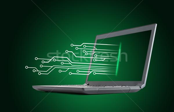 Laptop on green background Stock photo © cherezoff