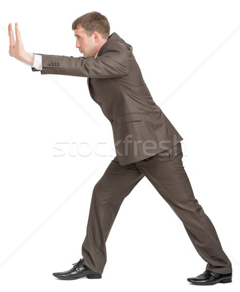 Businessman pushing empty space  Stock photo © cherezoff