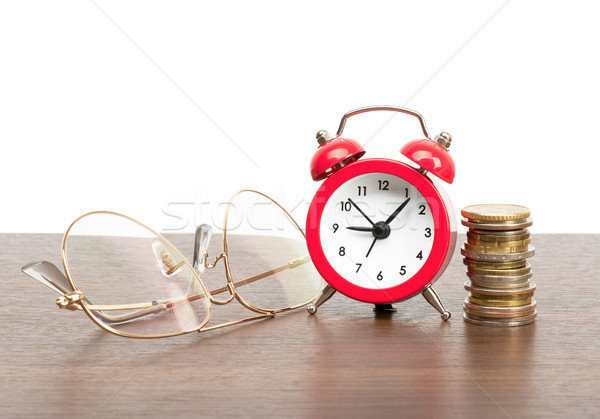 Alarm clock with stack of coins Stock photo © cherezoff