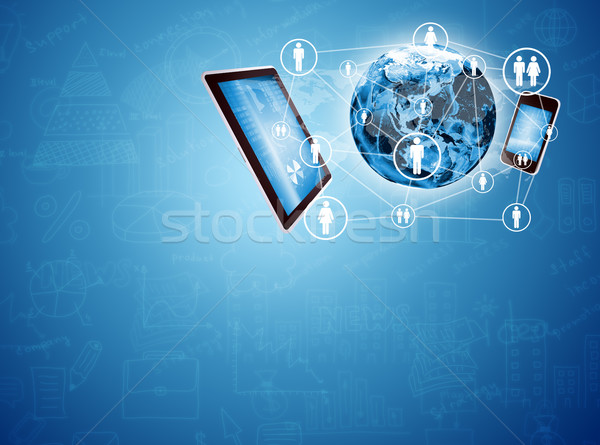 Earth between smartphone and tablet Stock photo © cherezoff