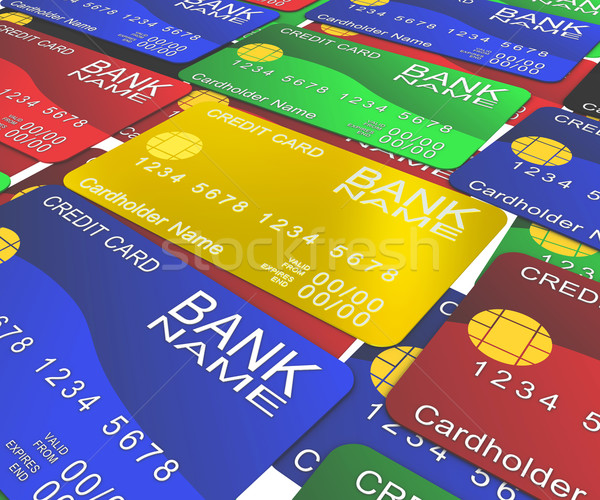 Multi-colored plastic cards. In the middle of the gold card Stock photo © cherezoff