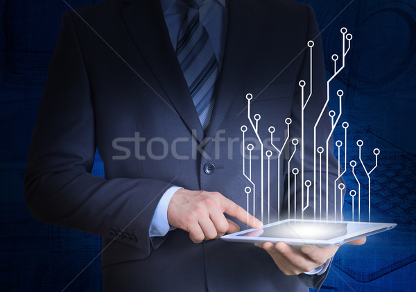 Businessman in a suit holding a tablet computer Stock photo © cherezoff